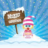Vector cartoon merry Christmas elf on north pole. Vector cartoon cute merry Christmas elf standing on winter snow landscape near wooden sign board with greeting Royalty Free Stock Photos