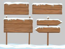 Vector cartoon set of blank wooden signs covered with snow and i. Ce  on grey background Stock Image