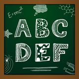 Vector chalk drawing alphabet. On green background. Eps10 Stock Image