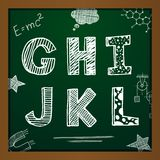 Vector chalk drawing alphabet. On green background. Eps10 Royalty Free Stock Photo