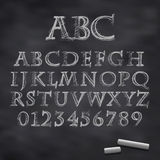 Vector chalk font. Vector illustration of a chalk alphabet on a blackboard Royalty Free Stock Photography