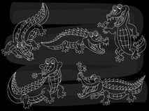 Vector Chalkboard Crocodiles Set. Vector Set of Crocodiles on Blackboard Background. Stock Images