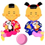 Vector Chinese baby boy and girl. In national costume and sits holding a toy panda Royalty Free Stock Photo