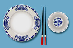 Vector of Chinese porcelain with chopsticks Royalty Free Stock Images