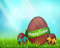 Vector  chocolate easter eggs  on green Stock Photo