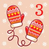 Warm winter mittens on a beige background. Royalty Free Stock Photo