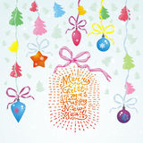 Vector Christmas card with Christmas balls, trees, hand written text 'Merry Christmas and Happy New Year' and garland Royalty Free Stock Image