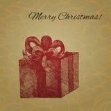 Vector Christmas card with hand drawn gift box Stock Image