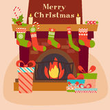 Vector Christmas fireplace and gifts near it Royalty Free Stock Photography