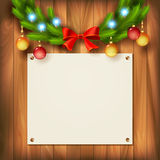 Vector Christmas garland on wooden wall Stock Photo
