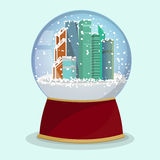 Vector Christmas Glass globe with the falling snow and Moscow-City in it. Royalty Free Stock Image