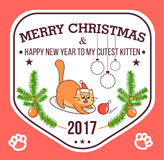 Vector Christmas greeting card in badge shape . Fat cat playing with xmas toy. Bright happy colors. Cute design in Royalty Free Stock Images