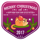 Vector Christmas greeting card in badge shape . Fat cat playing with xmas toy. Bright happy colors. Cute design in Royalty Free Stock Photo