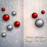 Vector christmas greeting card with  balls on snow Royalty Free Stock Image