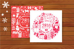 Vector  Christmas greeting card templates on wood table, Merry Christmas. Wreath design made of childish doodles: Santa, houses, d Royalty Free Stock Images