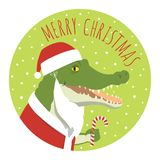 Crocodile santa claus round sticker. Vector Christmas illustration of a crocodile in a Santa Claus costume smiling and holding candy cane. Round format. Lime Royalty Free Stock Photo