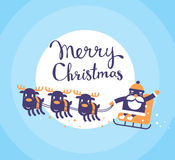 Vector christmas illustration of flying santa claus on sleigh an. D reindeers with handwritten text merry christmas on blue background with moon. Hand draw flat Royalty Free Stock Photos
