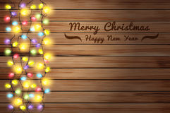 Vector christmas lights on wooden background royalty free illustration