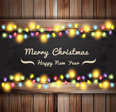 Vector christmas lights on wooden boards and chalkboard Stock Photos