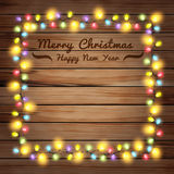 Vector christmas lights on wooden boards Stock Photos