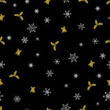 Vector Christmas seamless pattern from white snowflakes, golden bells and berry on black background. Stock Images