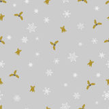 Vector Christmas seamless pattern from white snowflakes, golden bells and berry on grey background. Royalty Free Stock Images