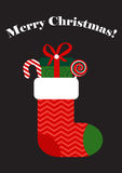 Vector christmas sock with gift box and candies Stock Images