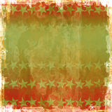 Vector Christmas Stars Grunge. Red and green Christmas colors grunge background with stars. Vector also Royalty Free Stock Photo