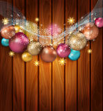 Vector Christmas template with Christmas balls. Snowflakes, on a wooden background Royalty Free Stock Photo