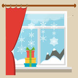 Vector Christmas window with a view of the winter landscape decorated with garlands of snowflakes. A stack of gifts on the window. Royalty Free Stock Photo
