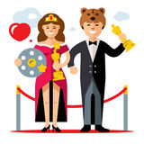 Vector Cinema Award. Best Actor and Actress. Flat style colorful Cartoon illustration. Man in tuxedo and woman in evening dress with a gold statuettes. Isolated Stock Photo