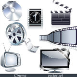 Vector cinema icons. Film reel, stack of reels, film strip and clapboard Royalty Free Stock Images