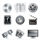 Vector cinema icons. Film reel, stack of reels, film strip and clapboard : film reel, stack of reels, film strip and clapboard Stock Photo