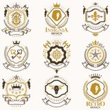 Vector classy heraldic Coat of Arms. Collection of blazons styli. Zed in vintage design and created with graphic elements, royal crowns and flags, stars, towers Royalty Free Stock Images