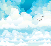 Vector clouds on a blue sky with birds Royalty Free Stock Photos