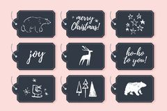 Vector collection of christmas cards, gift tags and badges isolated on black background. Emblems for xmas holiday presents packaging in hand drawn sketch style vector illustration