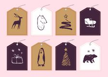 Vector collection of christmas gift tags & badges isolated on light background. Emblems for xmas holiday presents packaging in hand drawn sketch style. Deer royalty free illustration