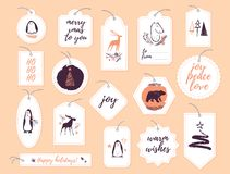 Vector collection of christmas gift tags & badges isolated on light background. Emblems for xmas holiday presents packaging in hand drawn sketch style. Fir stock illustration