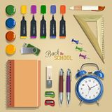 Vector Collection of colorful School Supplies. Set of school supplies, lying on a table. The view from the top Royalty Free Stock Image