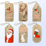 Vector collection of six cute christmas gift tags with Santa, bullfinch, hare and red nose reindeer Rudolph royalty free illustration