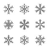 Vector collection of snowflakes, black icon on a white background. Black icon on a white background Royalty Free Stock Photography