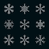 Vector collection of snowflakes, white icon on a black background Stock Photography