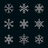 Vector collection of snowflakes, white icon on a black background Stock Images