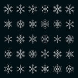 Vector collection of snowflakes, white icon on a black background Royalty Free Stock Image
