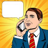Vector color pop art comic style illustration of a young man talking on a cell phone. Businessman with phone in hand. The seller is talking on the mobile phone stock illustration