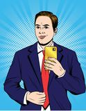Vector color pop art style illustration of a business man in a suit doing selfie. stock illustration