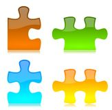 Vector Colored Puzzle Pieces. Vector Colored Glossy Puzzle Pieces with reflection Royalty Free Stock Images
