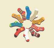 Vector colored socks in a circle on a beige Royalty Free Stock Photo