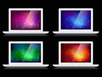 Vector colorful backgrounds and laptops. Vector laptops isolated on black - with shiny colorful backgrounds in red, green, blue, orange colors Royalty Free Stock Images