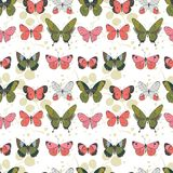 Vector green, coral, pink and light gray flying butterflies seamless pattern on light colored leaves background royalty free illustration